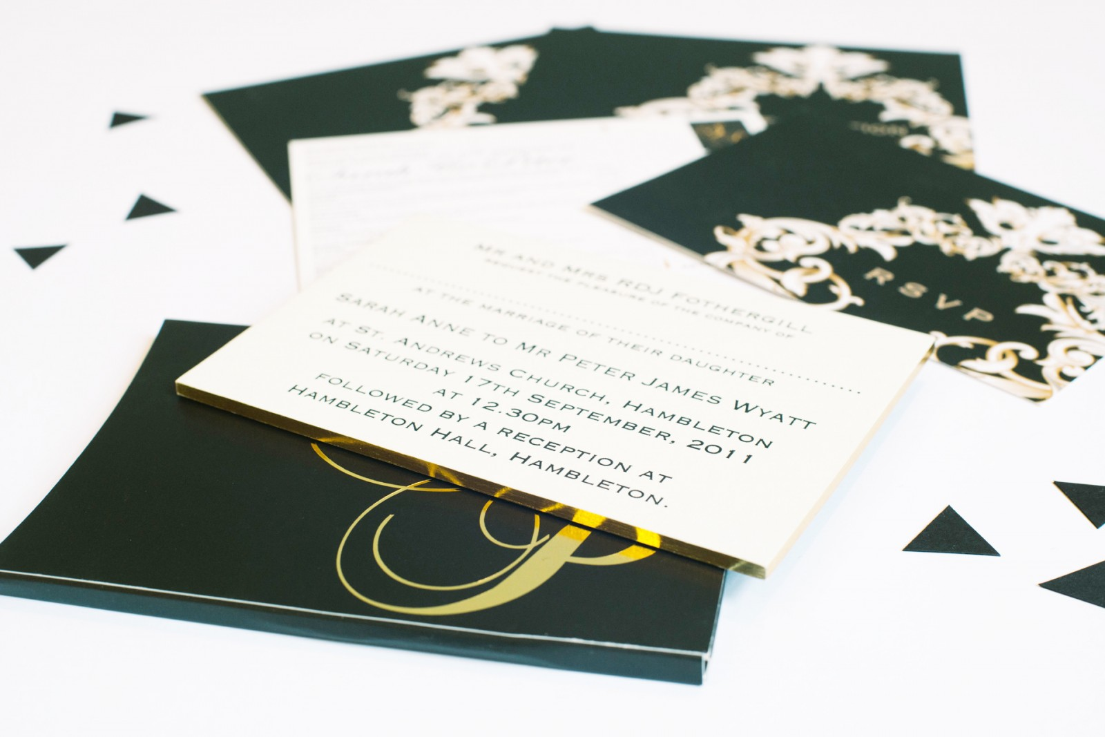 Gold gilt edging beautifully finishes a sophisticated gold, black & white design of thermography, foiling & calligraphy....